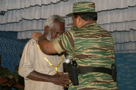 LTTE leader Mr. V. Pirapaharan felicitates Poet Naavannan