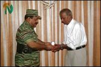 LTTE leader felicitates expatriate language activist