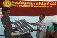 SEDB Visuvamadu branch Manager Mr.Rajmathan is seen handing over solar power plant to a beneficiary