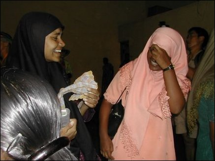 Muslim girls enjoying Patch Admas show