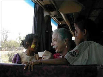 Dr. Patch Adams with children inside his bus