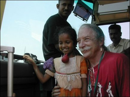 Dr. Patch Adams with a child