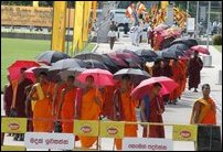 Monks walking from YMBA towards BMICH