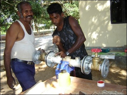 Workers installing necessary piping equipment for the deploying the network of pipes for drip irrigation.
