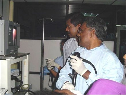 Dr Moorthy, a Gastro-enterologist from California, USA helping Dr Sivapalan in diagnosing a patient.