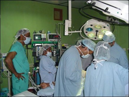 Dr Ganenthiran, an anaesthesiologist, helping in a surgery at the hospital.