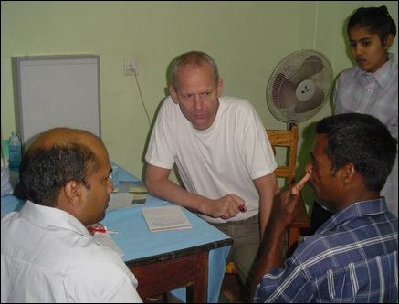 Norwegian plastic surgeon, Dr Louis de Weerd, talking to a patient on the needs for performing a plastic surgery to correct facial deformity.