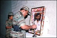 Pirapaharan lighting ceremonial lamp to Ponnamman's picture