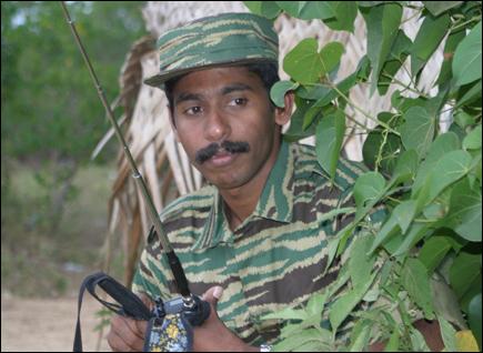 http://www.tamilnet.com/img/publish/2006/05/ltte_lt_col_veeramani.jpg