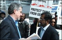 Elias Jeyarajah handing over memorandum to Jeremy Mark