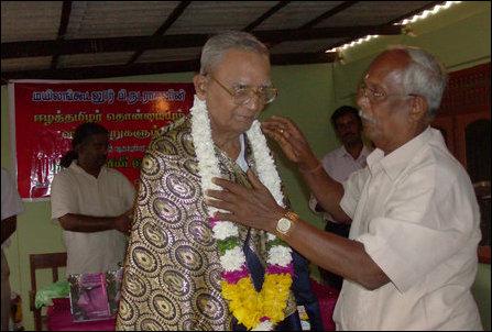 Professor Sivalingarajah garlanding Mr Nadarajan