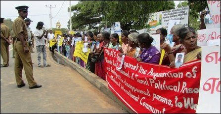Kilinochchi rises up against resettlement farce and sl for Farcical antonym