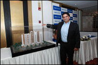 Managing Director and CEO of Tata Housing, Mr Brotin Banerjee is seen with the 3D model of the propo
