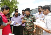SL military with journalists from South